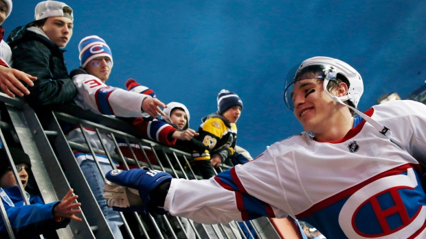 Montreal Canadiens' Brendan Gallagher greets fans as he comes off the field following the NHL Winter Classic hockey game against the Boston Bruins at Gillette Stadium in Foxborough, Mass., Friday, Jan. 1, 2016. The Canadiens won 5-1. (AP Photo/Michael Dwyer)