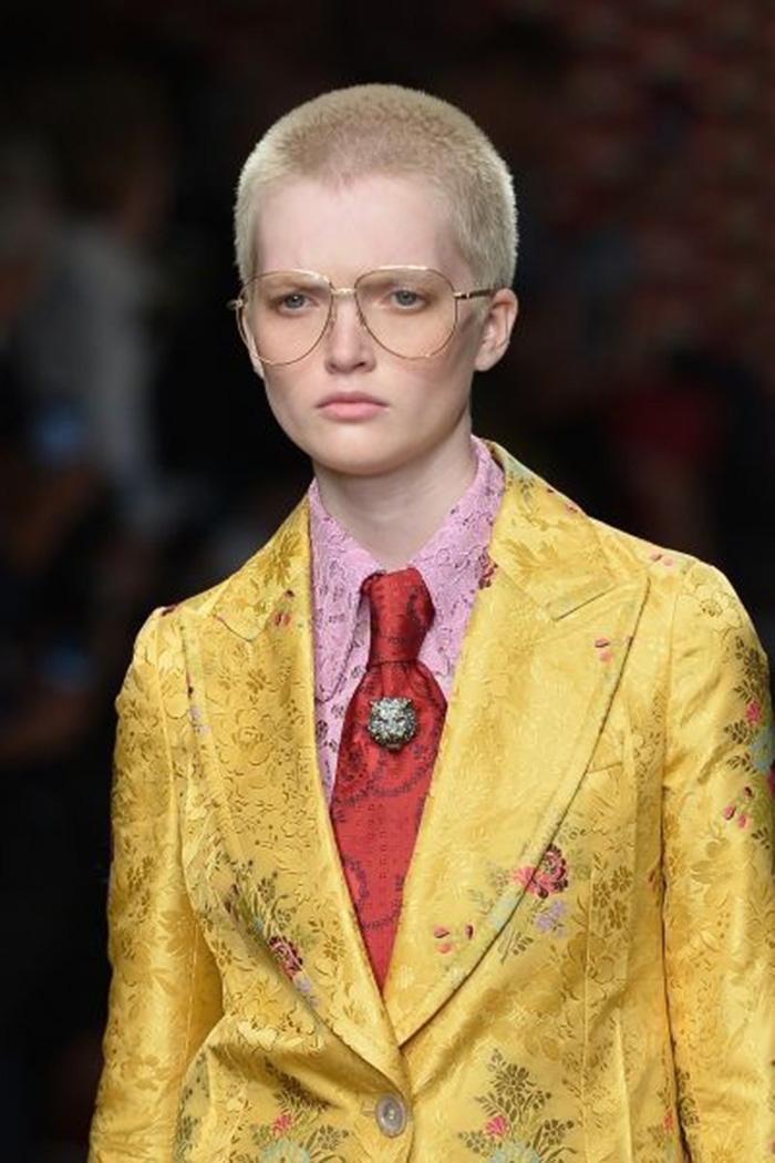 A model dons eyewear on the Gucci catwalk during the women Spring/Summer 2016 Milan's Fashion Week. AFP / Tiziana Fabi)