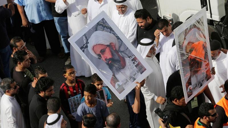 Saudis carry a poster demanding freedom for jailed Shiite cleric Sheikh Nimr al-Nimr, during a funeral procession, in Tarut, Saudi Arabia, Saturday, May 30, 2015.  (AP / Hasan Jamali)