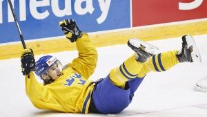 Sweden's Oskar Lindblom celebrates scoring against Slovakia during the 2016 IIHF World Junior Ice Hockey Championships quarterfinal match between Sweden and Slovakia in Helsinki, Finland, Saturday Jan. 2, 2016. (Roni Rekomaa / Lehtikuva via AP)
