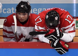Canada's John Quenneville (22) and Travis Konecny (17) react to their team's loss against Finland following quarter-final hockey action at the IIHF World Junior Championship, in Helsinki, Finland, on Saturday, Jan. 2, 2016. (Sean Kilpatrick / THE CANADIAN PRESS)