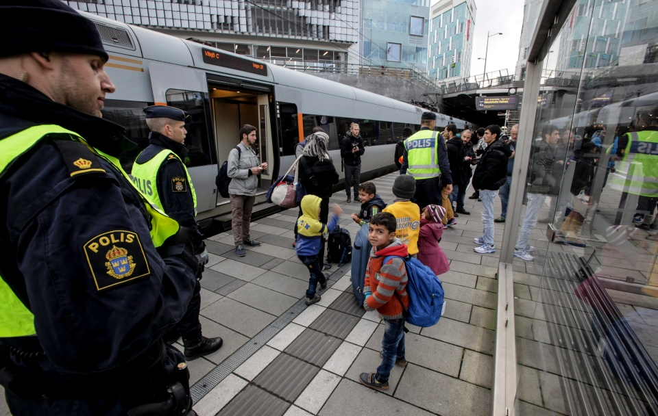 A group of migrants off an incoming train gather on the platform at the Swedish end of the bridge between Sweden and Denmark in Malmo Sweden. (Stig Ake Jonsson/TT via AP)