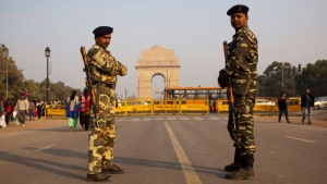 Indian security men guard near the India Gate War memorial as part of enhanced security measures following the attack on an air force base near the country's border with Pakistan, New Delhi, India, Sunday, Jan. 3, 2016.  (AP /Tsering Topgyal)