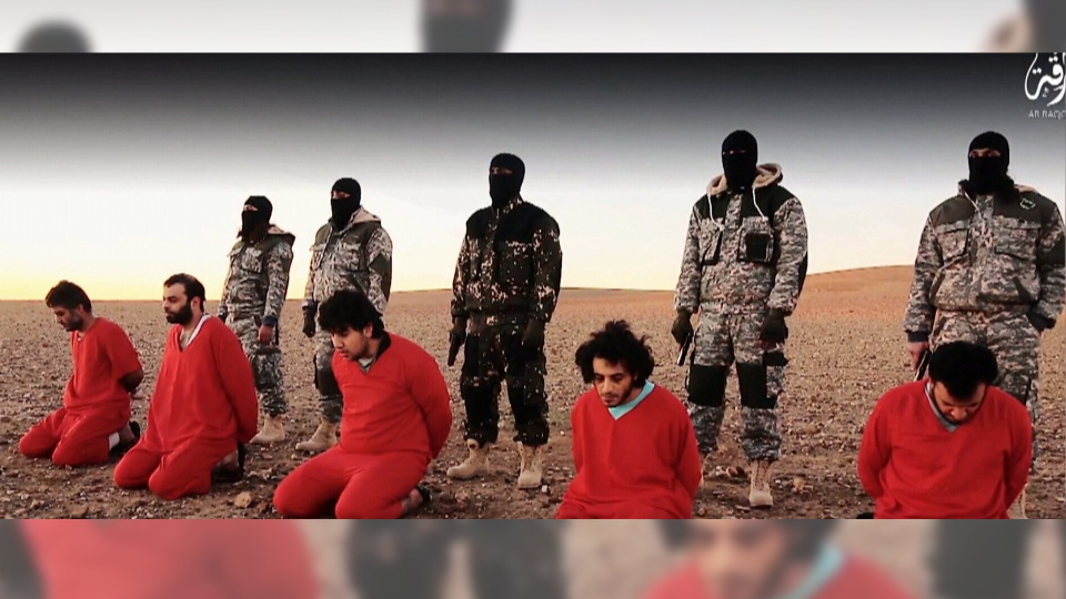 A image shows a still frame from an online video that purports to show Islamic State militants executing five men.