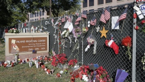 Flowers and American flags honoring the victims of the attack on Dec 2 are placed outside the Inland Regional Center where the fatal shooting took place in San Bernardino, Calif. (AP Photo / Nick Ut)