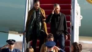 President Barack Obama, first lady Michelle Obama and their daughters Sasha and Malia arrive at Andrews Air Force Base, Md., Sunday, Jan. 3, 2016, as they return from vacation in Hawaii. (AP / Jose Luis Magana)
