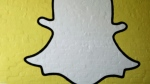 In this Thursday, Oct. 24, 2013 file photo, part of the Snapchat logo is shown on a wall in Los Angeles. (AP /Jae C. Hong)