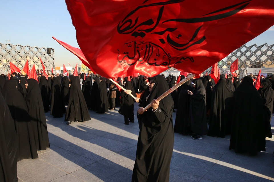 Iranian women wave flags that read, 'Death to America and we shall never accept humiliation,' during a rally to protest the execution by Saudi Arabia last week of Sheikh Nimr al-Nimr, a prominent opposition Saudi Shiite cleric, in Tehran, Iran, Monday, Jan. 4, 2016. (AP / Vahid Salemi)
