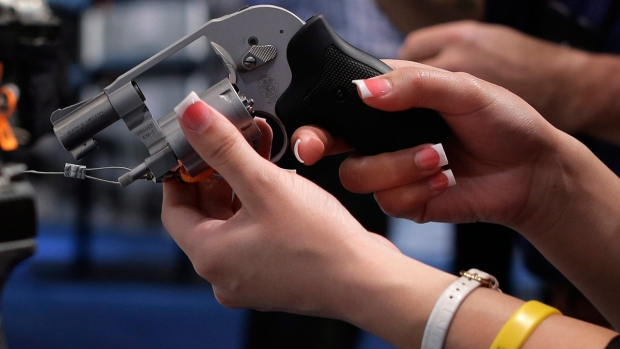 A buyer examines a revolver in Las Vegas