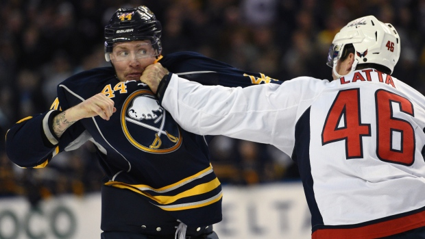 Buffalo Sabres winger Nicolas Deslauriers (44) eyes Washington Capitals centre Michael Latta (46) during a fight in Buffalo, N.Y., on Monday, Dec. 28, 2015. (AP Photo/Gary Wiepert)