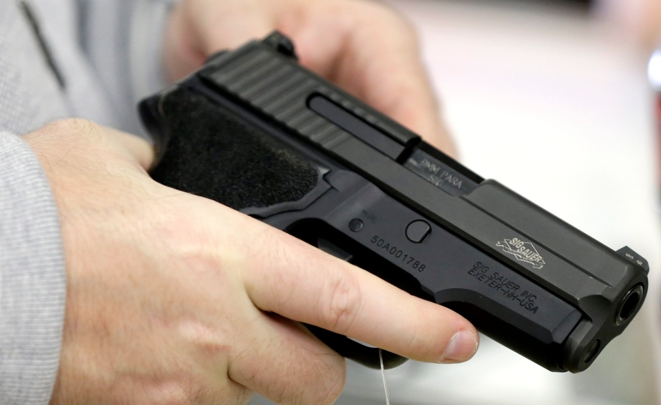 In this file photo, a man holds a handgun while shopping at the Spring Guns and Ammo store Monday, Jan. 4, 2016, in Spring, Texas. (AP / David J. Phillip)