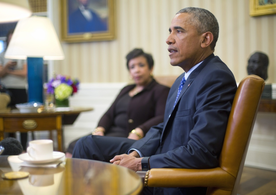 U.S. Attorney General Loretta Lynch listens as President Barack Obama speaks in the Oval Office of the White House in Washington, Monday, Jan. 4, 2016, during a meeting with law enforcement officials to discuss executive actions the president can take to curb gun violence. (AP / Pablo Martinez Monsivais)
