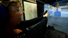 Michelle Morrow practices on the shooting range