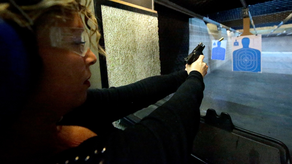 Michelle Morrow practices on the shooting range at the Spring Guns and Amo store, in Spring, Texas, Monday, Jan. 4, 2016. (AP / David J. Phillip)