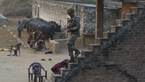 An Indian army soldier descents the stairs of a house outside the Indian air force base in Pathankot, India, Sunday, Jan. 3, 2016. (AP / Channi Anand)