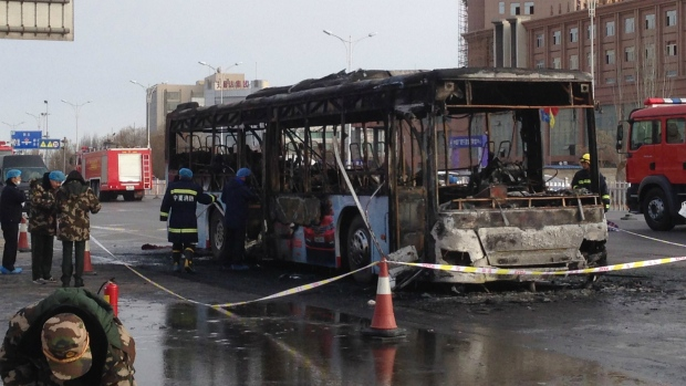 Suspect sought in deadly bus fire in China