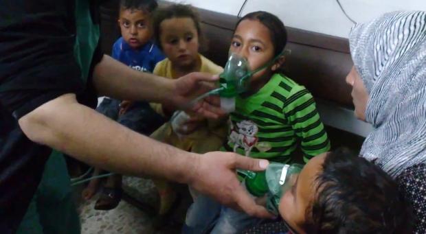 Children receive oxygen in Syria