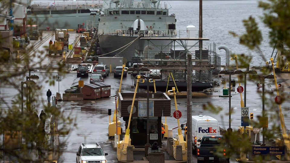 Vehicles enter Canadian Forces Base Halifax, in Halifax, on October 22, 2014. (Andrew Vaughan / THE CANADIAN PRESS)