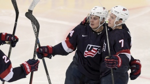Auston Matthews, left, and Matthew Tkachuk of the U.S celebrate a goal during the 2016 IIHF World Junior Ice Hockey Championship bronze medal game on Jan. 5, 2016. (Markku Ulander / Lehtikuva via AP)