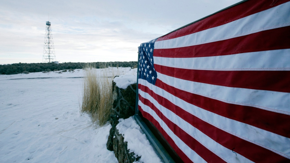 An American flag at the front entrance to the Malheur National Wildlife Refuge headquarters on Jan. 5, 2016. (Rick Bowmer / AP)