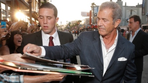 Mel Gibson signs autographs at the TCL Chinese Theatre in L.A. on Aug. 11, 2014. (Todd Williamson / Invision / AP)