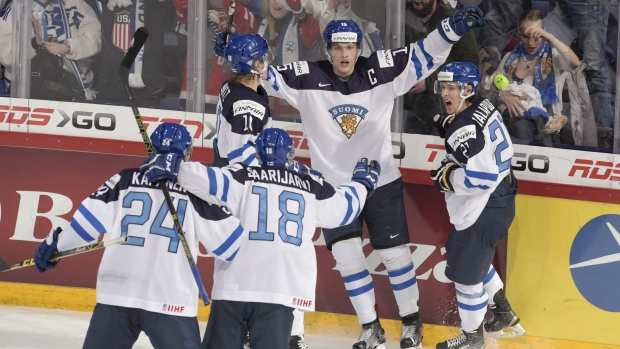 Captain Mikko Rantanen of Finland, centre, celebrates scoring with teammates during the 2016 IIHF World Junior Ice Hockey Championship final match between Finland and Russia in Helsinki, Finland, on Tuesday Jan. 5, 2016. (Markku Ulander/Lehtikuva via AP)