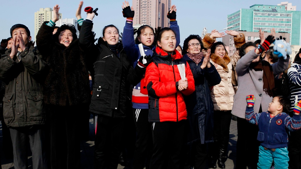 North Koreans react as they watch a news broadcast on a video screen outside Pyongyang Railway Station in Pyongyang, North Korea, Wednesday, Jan. 6, 2016. (AP / Kim Kwang Hyon)