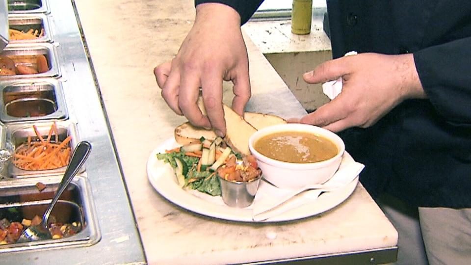 Landon Gossfeld prepares traditional indigenous meals at Neechi Commons in Winnipeg.