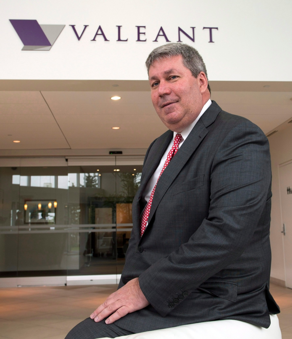 Valeant Pharmaceuticals International chief executive J. Michael Pearson poses for photographers after the company's annual meeting Tuesday, May 19, 2015 in Laval, Quebec. (Ryan Remiorz/THE CANADIAN PRESS)