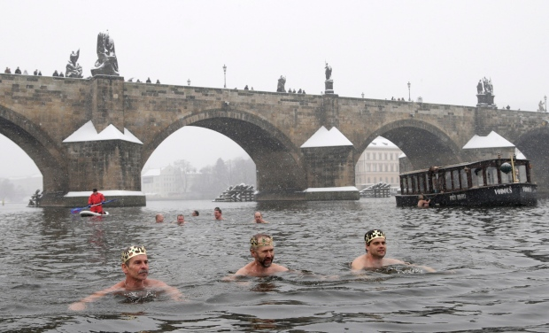Swimmers take part in the traditional Three Kings swim in the Vltava River in Prague, Czech Republic, Wednesday, Jan. 6, 2016. (AP / Petr David Josek)