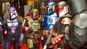 Costumed Star Wars 'Boba Fett' characters attend the New York Comic Con, on Oct. 14, 2011. (Charles Sykes / AP)