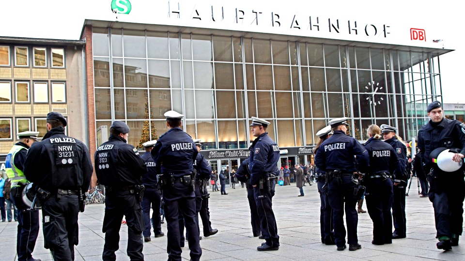 Police officers patrol in front of the main station of Cologne, Germany, on Wednesday, Jan. 6, 2016. More women have come forward alleging they were sexually assaulted and robbed during New Year's celebrations in the German city of Cologne, as police faced mounting criticism for their handling of the incident. (AP Photo / Hermann J. Knippertz)