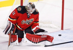 Calgary Flames' goalie Karri Ramo, from Finland, stops an Edmonton Oilers shot during second period NHL action in Calgary, Alta., on Dec. 27, 2015. (Larry MacDougal / The Canadian Press)