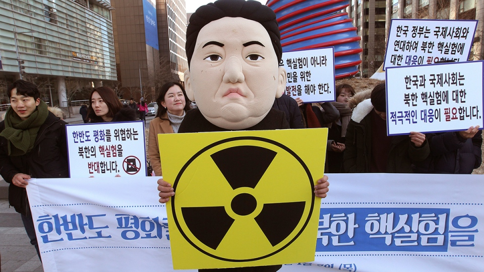 A South Korean university student wearing a mask depicting North Korean leader Kim Jong Un participates in a rally against North Korea's announcement that it had tested a hydrogen bomb in Seoul, South Korea, Thursday, Jan. 7, 2016. (AP / Ahn Young-joon)