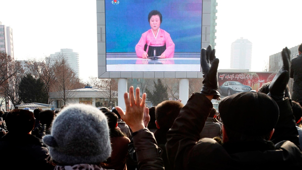 North Koreans watch a news broadcast on a video screen outside Pyongyang Railway Station in Pyongyang, North Korea, Wednesday, Jan. 6, 2016. (AP / Kim Kwang Hyon)