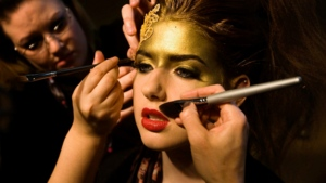 A model is worked on by make-up artists during Toronto Fashion Week Monday, March 29, 2010. (Darren Calabrese / THE CANADIAN PRESS)