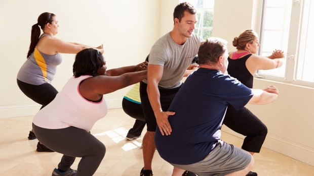 Overweight young adults at fitness class