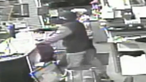 A robber is seen on surveillance video wielding a gun during a robbery at the Rocky Mountain Pawn Shop on Macleod Trail S.E. (Calgary Sun)
