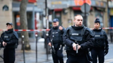 Paris police shoot knife-wielding man