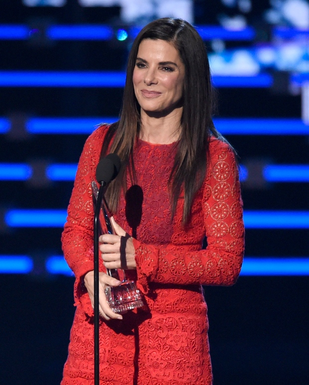"Sandra Bullock accepts the award for favorite movie actress for ""Our Brand Is Crisis"" at the People's Choice Awards at the Microsoft Theater on Wednesday, Jan. 6, 2016, in Los Angeles. (Photo by Chris Pizzello/Invision/AP)"