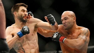Robbie Lawler, right, hits Carlos Condit during a welterweight championship mixed martial arts bout at UFC 195 in Las Vegas, Saturday, Jan. 2, 2016. (AP / John Locher)