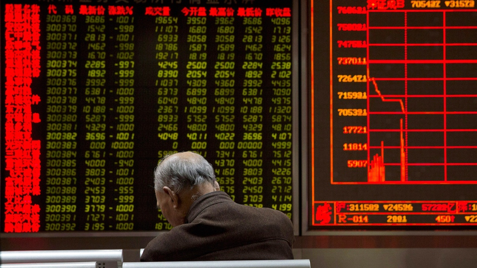 An investor rests near a display board showing the plunge in the Shanghai Composite Index at a brokerage in Beijing, China, Thursday, Jan. 7, 2016. (AP / Ng Han Guan)
