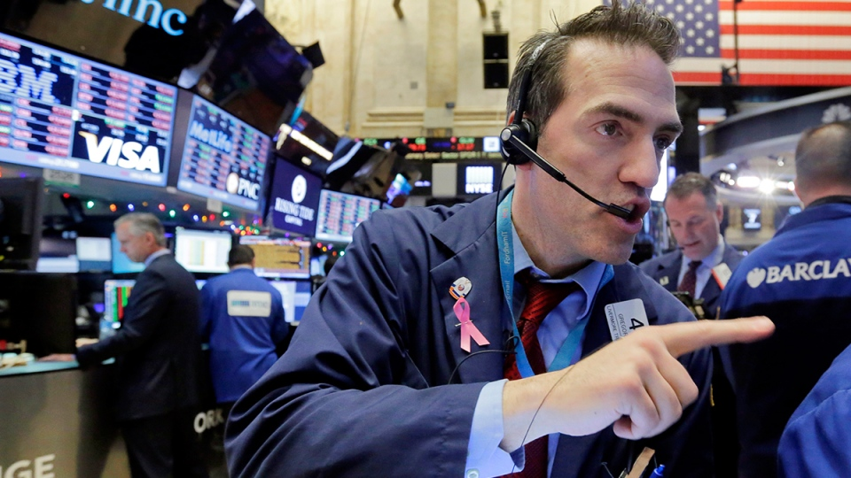 Trader Gregory Rowe, right, works on the floor of the New York Stock Exchange, Thursday, Jan. 7, 2016. (AP / Richard Drew)