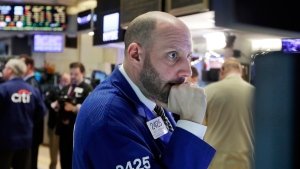 Specialist Meric Greenbaum works on the floor of the New York Stock Exchange, on Thursday, Jan. 7, 2016. (AP Photo/Richard Drew)