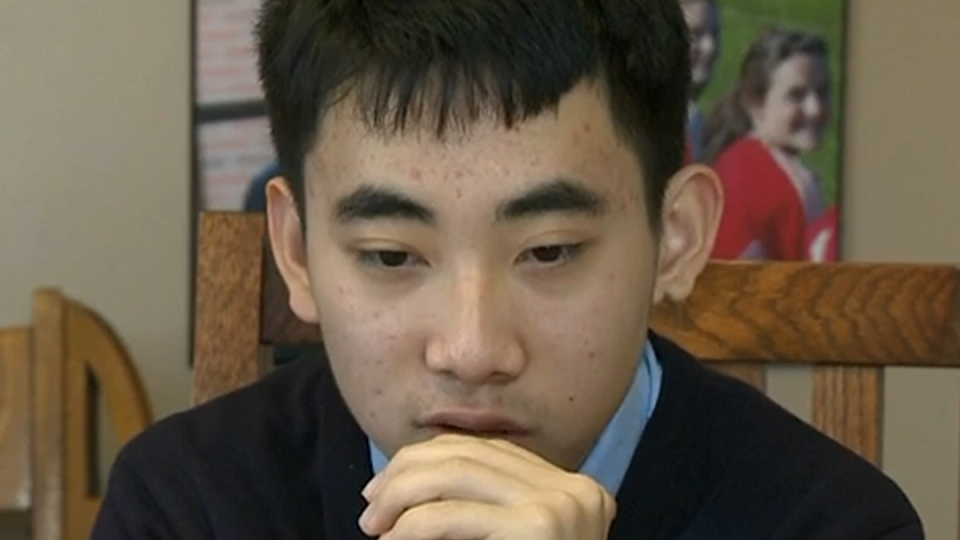 International Memory Master Evan Xie, 16, studies a deck of cards in Windsor, N.S.