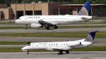 United Airlines and United Express planes prepare to take off at George Bush Intercontinental Airport in Houston, July 8, 2015. (AP Photo/David J. Phillip)