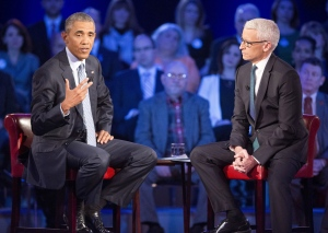U.S. President Barack Obama, left, speaks during a CNN televised town hall meeting hosted by Anderson Cooper, right, at George Mason University in Fairfax, Va., Thursday, Jan. 7, 2016. (AP / Pablo Martinez Monsivais)