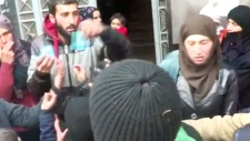 Families recieve aid in Madaya, Syria camp