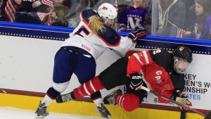 In this file photo, United States' Presley Norby (5) collides with Canada's Lindsay Agnew (19) during the third period of an IIHF Under 18 women's world championships hockey game, Monday, Jan. 5, 2015, in Buffalo, N.Y. (Harry Scull Jr. / AP Photo / The Buffalo News)