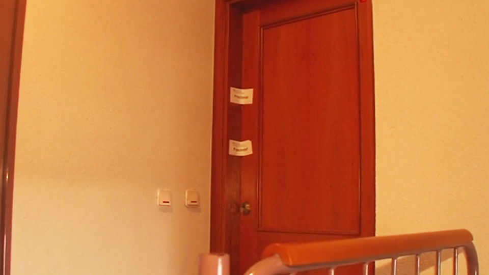 Police on tape blocks the door after the body of a boy was discovered under several blankets on a bed at the family's rented apartment in the city of Girona, Spain.